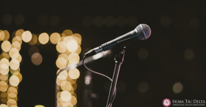 Microphone in front of white fairy lights